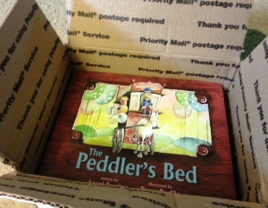 O. M. Gosh, it's my author copies of The Peddler's Bed!