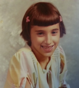 I'm nearly 9 in this photo. I still look cute; what the heck happened to me?! Well, I'll spare you my awkward teen years. Trust me, you do not want to see those photos! :) (I really should burn them one of these days.)