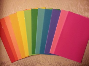 {a rainbow of blank books}