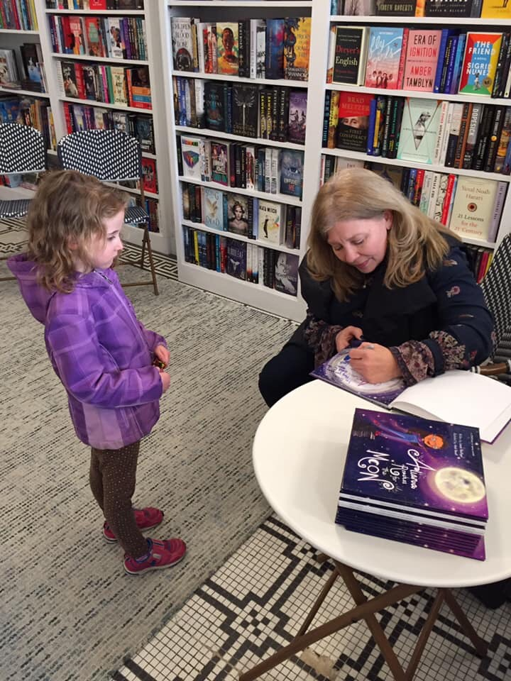 Laura signing girl in purple